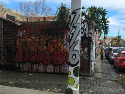 graffiti street number and street art in fitzroy - friendship is everything