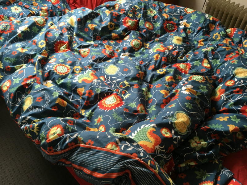 warmth of new bedspread - bright colours and light