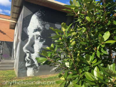 graffiti days - painting of woman's face with greenery in the foreground