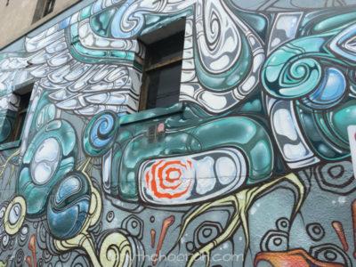 interesting grey and blue and orange street art graffiti in collingwood