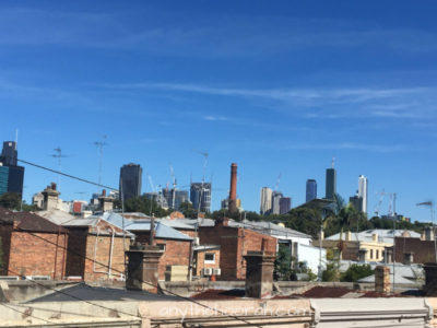 view over rooftops towards melbourne city