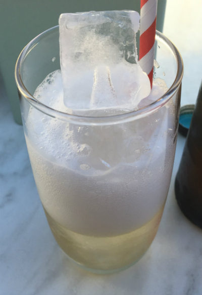 effervescent drink on ice with paper straw