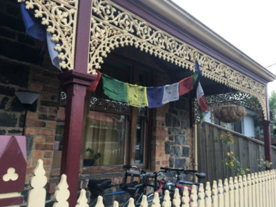 peace flags, bikes, picket fence, brick house frontage