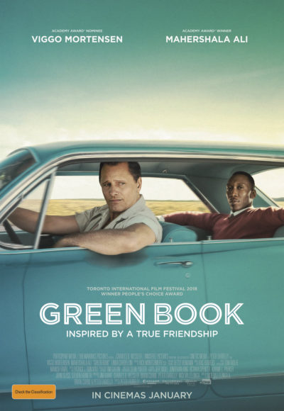 Green Book - a story of true friendship - tony and don in a blue green cadillac driving through the usa
