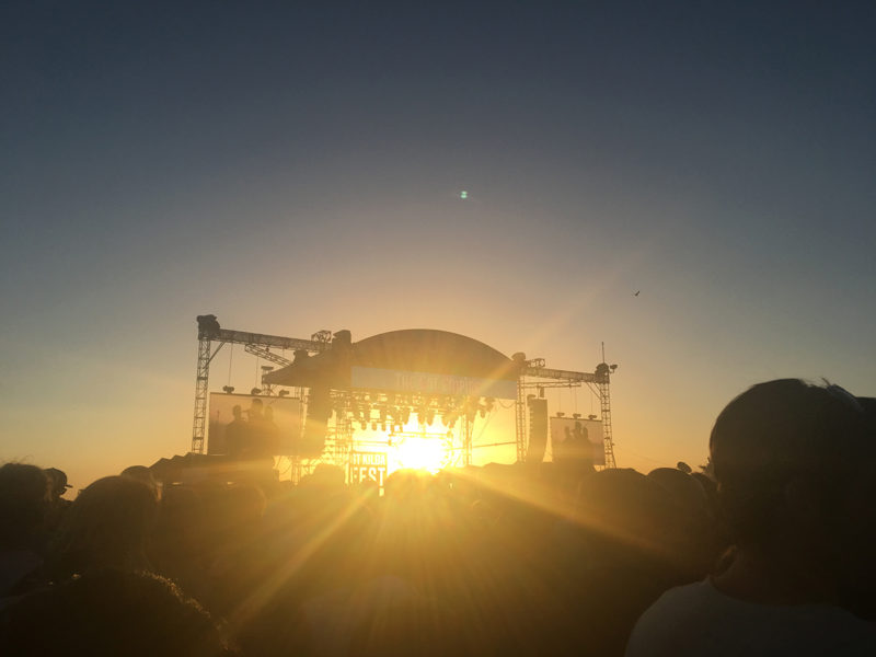 main stage with thousands of people at sunset at st kilda festival