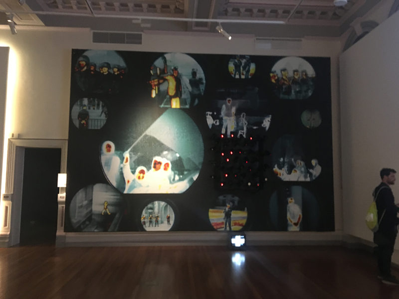 surveillance images and cameras on huge canvas in model citizens exhibition