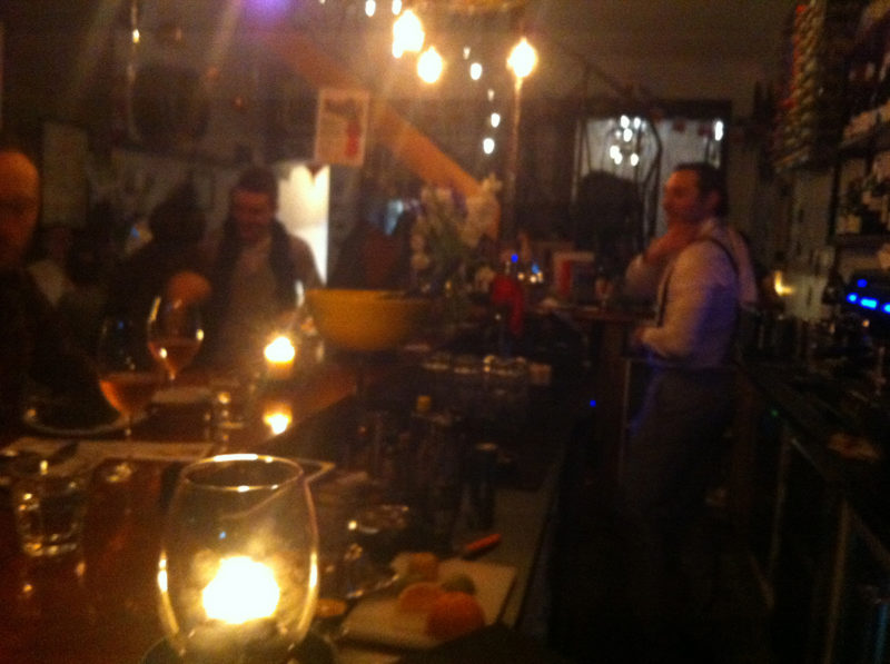 sebastien working the bar at bon ap with dappled lights and blurry focus