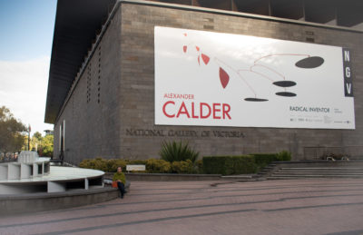 wideshot view of NGV with Calder poster